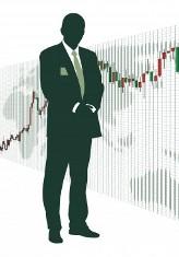 Мужчина на фоне графика акций - брокер